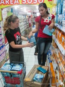 Shopping for formulated milk to distribute to babies. | Belanja susu formula untuk dibagikan pada anak bayi.